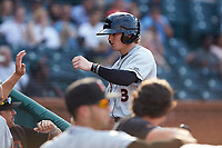 Cadyn Grenier (3) of the Delmarva Shorebirds is greeted by his teammates after scoring a run against the Greensboro Grasshoppers at First National Bank Field on August 26, 2018 in Greensboro, North Carolina. The Shorebirds defeated the Grasshoppers 6-4. (Brian Westerholt/Four Seam Images)