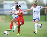 Boyds MD - April 19, 2014: Crystal Dunn (19) of the Washington Spirit goes against Kassey Kallman (14) of FC Kansas City. The Washington Spirit defeated the FC Kansas City 3-1 during a regular game of the 2014 season of the National Women's Soccer League at the Maryland SoccerPlex.