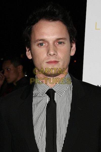 "Anton Yelchin.The New York Premiere of ""Like Crazy"" at the Landmark Sunshine Cinema, New York, NY, USA..October 18th, 2011.headshot portrait black suit tie grey gray shirt.CAP/LNC/TOM.©TOM/LNC/Capital Pictures."