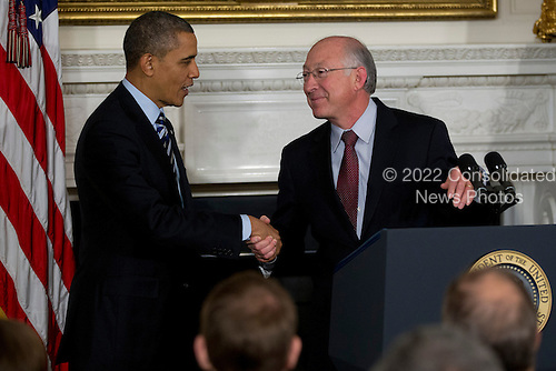 United States President Barack Obama, left, shakes hands with Ken Salazar, U.S. Secretary of the Interior, during an announcement for Sally Jewell, chief executive officer of Recreational Equipment Inc., unseen, as a nominee to become U.S. Secretary of the Interior at the White House in Washington, D.C., U.S., on Wednesday, Feb. 6, 2013. Jewell's background as an engineer and experience in the banking, energy and retail industries give her the skills needed to manage a department that oversees 500 million acres of public land, Obama said. .Credit: Andrew Harrer / Pool via CNP
