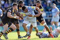 Mako Vunipola of Saracens is stopped by Tom Lindsay, Simon McIntyre and Nathan Hughes of London Wasps during the Aviva Premiership match between London Wasps and Saracens at Adams Park on Saturday 29th March 2014 (Photo by Rob Munro)