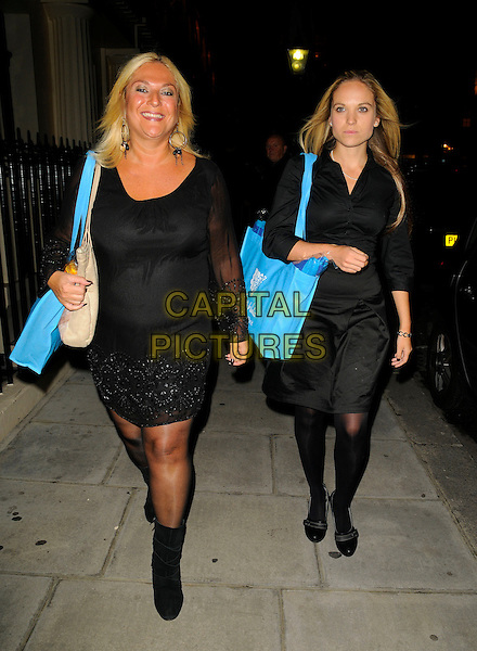 "VANESSA FELTZ & SASKIA.Attending Kathy Lette's ""To Love, Honour and Betray"" book launch party, London, England. .September 24th 2008.full length black dress tights boots blue bag mom mum daughter mother family .CAP/CAN.©Can Nguyen/Capital Pictures."