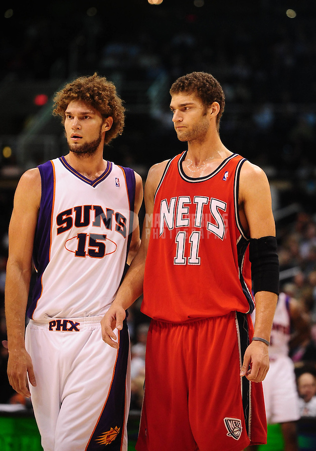 Jan. 20, 2010; Phoenix, AZ, USA; Phoenix Suns center (15) Robin Lopez stands alongside brother New Jersey Nets center (11) Brook Lopez in the second half at the US Airways Center.  The Suns defeated the Nets 118-94. Mandatory Credit: Mark J. Rebilas-