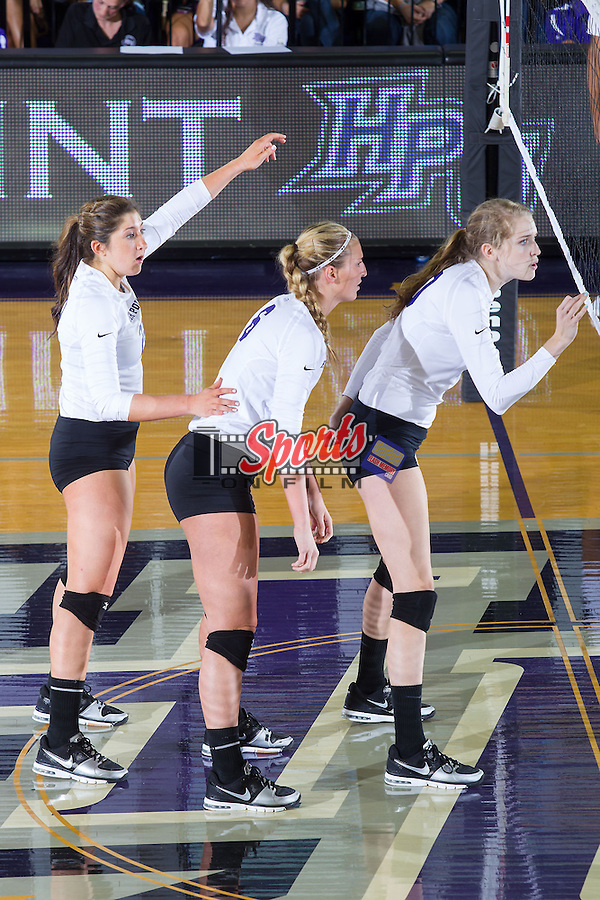 Crystal Widom (22), Megan Kennedy (6) and Savannah Angel (10) await a serve from the VCU Rams at Millis Athletic Center on September 17, 2013 in High Point, North Carolina.  The Rams defeated the Panthers 3-0.   (Brian Westerholt/Sports On Film)