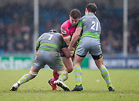 Exeter Cheifs' Ollie Devoto is tackled by Newcastle Falcons' Will Welchand Newcastle Falcons' Micky Young<br /> <br /> Photographer Bob Bradford/CameraSport<br /> <br /> Anglo Welsh Cup Semi Final - Exeter Chiefs v Newcastle Falcons - Sunday 11th March 2018 - Sandy Park - Exeter<br /> <br /> World Copyright &copy; 2018 CameraSport. All rights reserved. 43 Linden Ave. Countesthorpe. Leicester. England. LE8 5PG - Tel: +44 (0) 116 277 4147 - admin@camerasport.com - www.camerasport.com