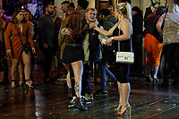 Pictured: A young woman embraces a young man in Wind Street, Swansea, Wales, UK. Friday 20 December 2019<br /> Re: Black Eye Friday (also known as Black Friday, Mad Friday, Frantic Friday) the last Friday before Christmas, in Swansea, Wales, UK.