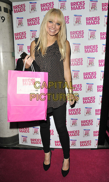 "Liz McClarnon.The ""Bridesmaids"" dvd launch party, Merah nightclub, Wells St., London, England..November 8th, 2011.full length black leggings pink bag beige polka dot top goody bag.CAP/CAN.©Can Nguyen/Capital Pictures."