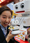 "June 9, 2016, Tokyo, Japan - An employee of Japanese toy maker Tomy displays a toy robot ""Baku Shotaro"" which can toss off a total of 1,300 gags at the annual Tokyo Toy Show in Tokyo on Thursday, June 9, 2016. Some 160,000 people are expecting to visit the four-day toy trade show.   (Photo by Yoshio Tsunoda/AFLO) LWX -ytd-"