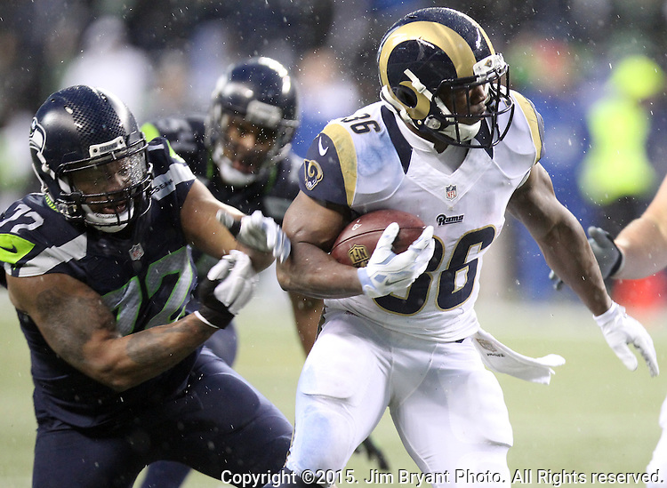 Seattle Seahawks defensive end Michael Bennett (72) reaches to grab St. Louis Rams running back Benny Cunningham (36) at CenturyLink Field in Seattle, Washington on December 27, 2015.  The Rams beat the Seahawks 23-17.      ©2015. Jim Bryant Photo. All Rights Reserved