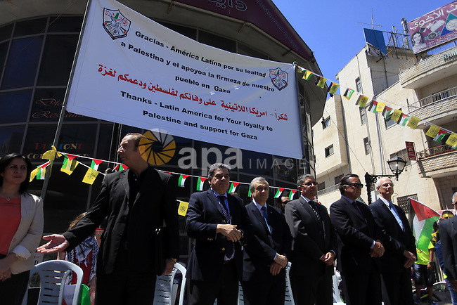 """Palestinians hold posters during a rally supporting South American countries, in the West Bank city of Ramallah, Monday, Aug. 11, 2014. During the war, Bolivia's president has declared Israel a """"terrorist state"""" while South American countries, including Brazil, Chile, Ecuador and Peru, have recalled their ambassadors from Israel because of its operation in the Gaza Strip. Photo by Shadi Hatem"""