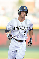 Tyler Saladino (8) of the Charlotte Knights rounds the bases after hitting a home run against the Indianapolis Indians at BB&T BallPark on June 20, 2015 in Charlotte, North Carolina.  The Knights defeated the Indians 6-5 in 12 innings.  (Brian Westerholt/Four Seam Images)