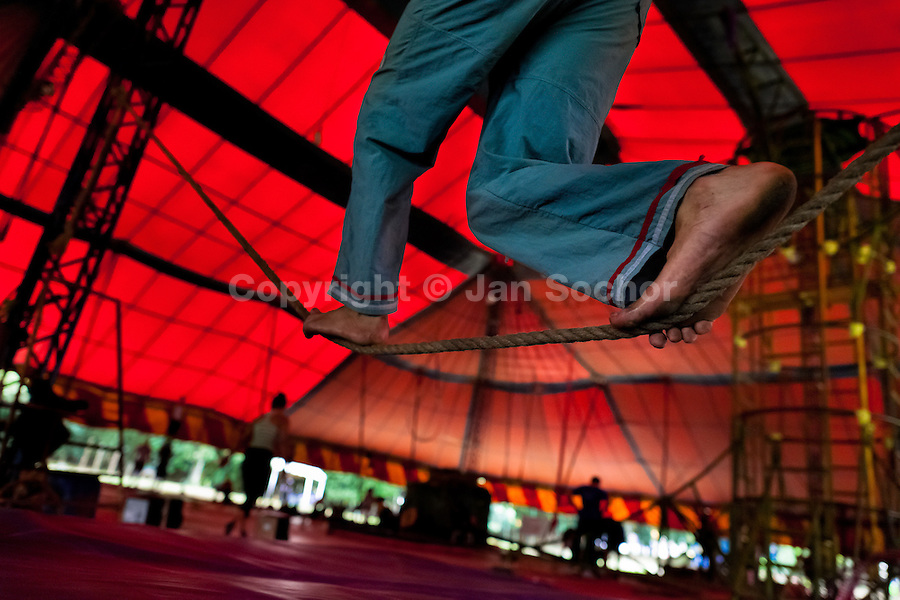 """A student trains for the high-wire acrobatics act during the lessons in the circus school Circo para Todos in Cali, Colombia, 2 June 2012. Circo Para Todos (""""Circus for All""""), founded by Felicity Simpson, a former British circus performer, is the first professional circus school in the world specifically dedicated to disfavoured kids and talented street children. Students are trained in a range of circus art skills including acrobatics, balancing, juggling, stilt walking or unicyling. After finishing the four-year course, graduates may find jobs in circuses in the world or in the cruise ships."""