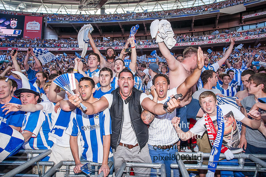 London, UK. Huddersfield Town fans celebrate after victory on penalties - nPower League One playoff final fixture Huddersfield Town versus Sheffield United at Wembley Stadium 26 May.  Please Byline David Fearn Pixel 8000 Ltd