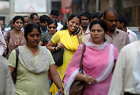 A woman talk on her mobile phone in the street during morning rush hour in Mumbai. Telenor warned it could be forced to reconsider its presence in India if the New Delhi revises the terms of its spectrum licence amid a political scandal over regulation of the Indian telecoms industry.<br /> <br /> Unitech, since renamed Uninor, is one of five companies alleged to have benefited from irregularities that an official audit claimed had cost the Indian government $39bn in lost revenues from spectrum licences. <br /> <br /> Further reading : http://www.ft.com/cms/s/0/f391ebb0-33b4-11e0-b1ed-00144feabdc0.html#axzz1DWW1eUZh