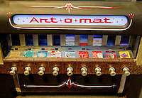An Art-O-Mat machine, a retired cigarette vending machines that have been converted to vend art, sits on display at the historic Cabarrus courthouse. There are over 90 active machines in various locations throughout the country. The Arts Council curates five galleries on the first floor of the 1876 historic Cabarrus courthouse.  The Galleries display works by regional and national artists working in a variety of media. Photo is part of a photographic series of images featuring Concord, NC, by Charlotte-based photographer Patrick Schneider..