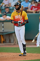 Jo Adell (26) of the Salt Lake Bees walks to the plate against the Oklahoma City Dodgers at Smith's Ballpark on August 1, 2019 in Salt Lake City, Utah. The Bees defeated the Dodgers 14-4. (Stephen Smith/Four Seam Images)