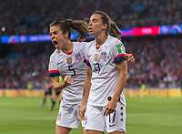 PARIS,  - JUNE 28: Kelley O'Hara #5 celebrates a goal withTobin Heath #17 during a game between France and USWNT at Parc des Princes on June 28, 2019 in Paris, France.