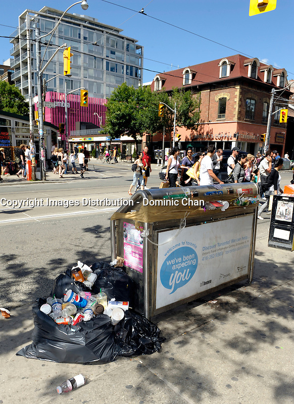Toronto (on) CANADA, July 4, 2009  Toronto Garbage Strike - full garbage can at Queen Street West