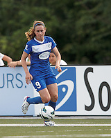 Boston Breakers midfielder Heather O'Reilly (9) dribbles down the wing. In a National Women's Soccer League (NWSL) match, Boston Breakers (blue) tied Western New York Flash (white), 2-2, at Dilboy Stadium on August 3, 2013.