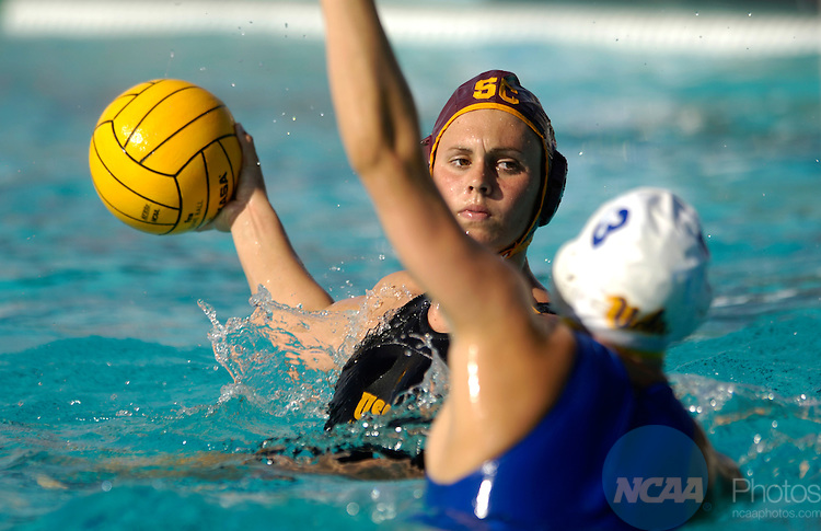 14 May 2006: Erica Figge (4) of USC prepares to take a shot on goal during the Division I Women's Water Polo Championship held at the Schaal Aquatics Center on the Campus of the University of California-Davis in Davis, CA. The University of California-Los Angeles defeated the University of Southern California 9-8 for the national title.  Stephen Nowland/NCAA Photos