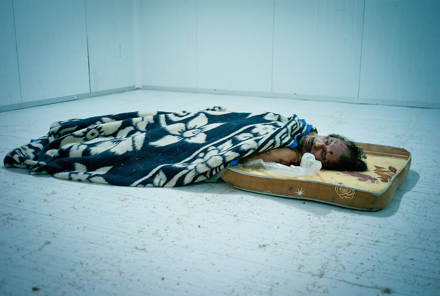 The body of Muammar Gaddafi lies in a commercial freezer at the African Tunisian Souq in Misrata, Libya, Saturday October 22, 2011. The confirmed death of Muammar Gaddafi brings closure to an 8 month uprising turned revolutionary war.
