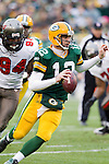 Green Bay Packers quarterback Aaron Rodgers (12) scrambles for yardage during a Week 11 NFL football game against the Tampa Bay Buccaneers on November 20, 2011 in Green Bay, Wisconsin. The Packers won 35-26. (AP Photo/David Stluka)