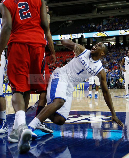 ATLANTA, GA. - Darius Miller falls during the game against Ole Miss in the SEC Tournament, at the Georgia Dome, Friday, March 11, 2011.  Photo by Latara Appleby | Staff