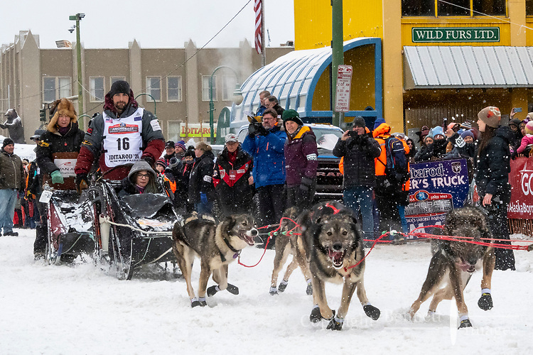 Richie Diehl and team leave the ceremonial start line with an Iditarider and handler at 4th Avenue and D street in downtown Anchorage, Alaska on Saturday March 7th during the 2020 Iditarod race. Photo copyright by Cathy Hart Photography.com