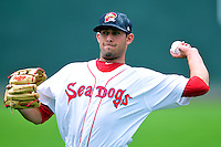 Portland Sea Dogs starting pitcher Mickey Pena #26 prior to a game versus the Trenton Thunder at Hadlock Field in Portland, Maine on May 17, 2014. (Ken Babbitt/Four Seam Images)