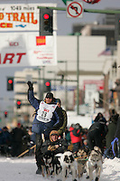 Zack Steer waves to the crowds on 4th avenue in Anchorage on Saturday March 1st during the ceremonial start day of the 2008 Iidtarod Sled Dog Race.