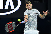 January 27, 2017: Grigor Dimitrov of Bulgaria in action in a semifinals match against Rafael Nadal of Spain on day 12 of the 2017 Australian Open Grand Slam tennis tournament in Melbourne, Australia. Photo Sydney Low