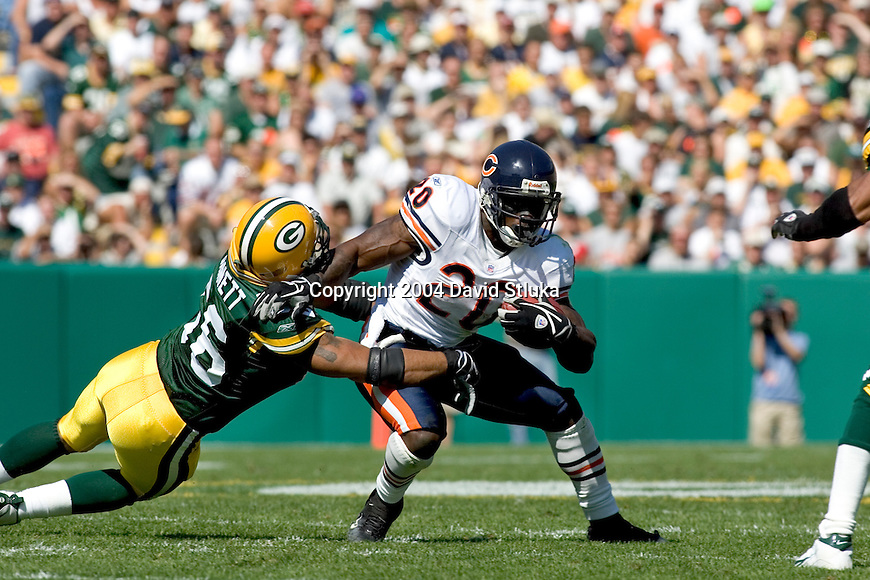 Linebacker Nick Barnett #56 of the Green Bay Packers tackles running back Thomas Jones #20 of the Chicago Bears during an NFL football game at Lambeau Field on September 19, 2004 in Green Bay, Wisconsin. The Bears beat the Packers 21-10. (Photo by David Stluka)