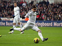Saturday 19 January 2013<br /> Pictured: Pablo Hernandez of Swansea takes a shot off target.<br /> Re: Barclay's Premier League, Swansea City FC v Stoke City at the Liberty Stadium, south Wales.