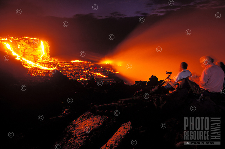 People watching the wonders of nature as lava flows from Kilauea, the worlds most active  volcano