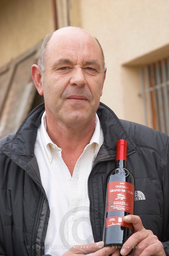 Jean-Noël Bousquet Chateau Grand Moulin. In Lezignan-Corbieres. Les Corbieres. Languedoc. Owner winemaker. France. Europe. Bottle.