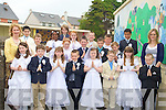 With their Principal of Moyderwell Primary School, Tralee Myra Quinlan and their teacher Miss Joanne O'Connor after they made their Holy Communion on Saturday in St John's Church, Tralee. Pupils, Adrian Cenalia, Patrick Cronin, Edvardas Mekauskas, Ellie Foley, David Moriarty, Alusin Jah, Nathan O'Rourke, Oisin Spillane, Catherine Belykov, Adam Breen, Michael Kerins, Renee Brosnan, Kristin Lewandowski, Sylvester Trafney, Desiree Fitzgerrald, Leah canty, Eammanuella Itdese, Jake Reidy, Mark Leahy and Roberty Sivak. Missing were, Abbey Ward and Katelyn Quillegan................................... ....