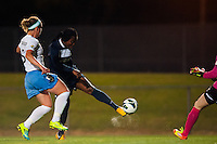 Sky Blue FC forward Danesha Adams (9) takes a shot as Chicago Red Stars defender Carmelina Moscato (5) defends. Sky Blue FC and the Chicago Red Stars played to a 1-1 tie during a National Women's Soccer League (NWSL) match at Yurcak Field in Piscataway, NJ, on May 8, 2013.