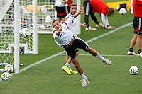 Lukas Podolski of Germany plays in goal during training