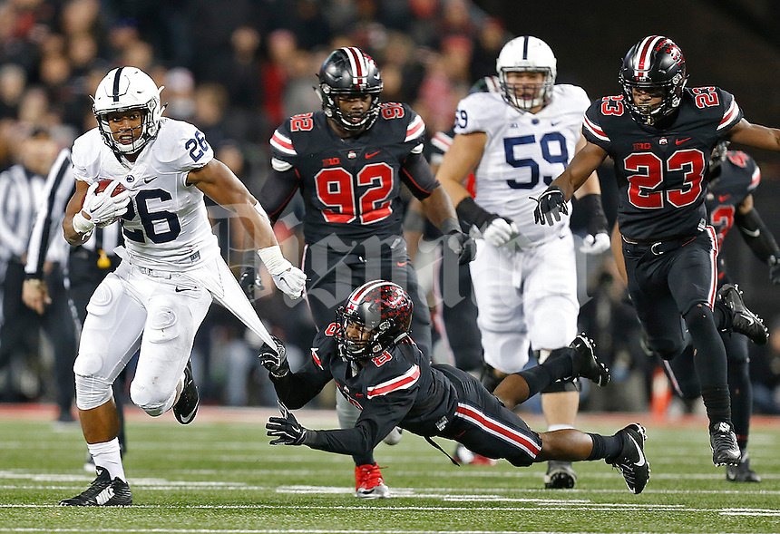 Ohio State Buckeyes cornerback Gareon Conley (8) can't stop Penn State Nittany Lions running back Saquon Barkley (26) in third quarter play at Ohio Stadium on October 17, 2015. (Chris Russell/Dispatch Photo)