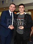 Mark Fay recieves the St Mary's GAA Club  Most improved player award from Club Manager Hugh Dourigan at their awards night in their clubrooms. Photo:Colin Bell/pressphotos.ie
