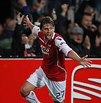 Nederland, Alkmaar, 29 maart 2012.Europa League.Seizoen 2011-2012.AZ-Valencia (2-1) .Brett Holman van AZ schreeuwt het uit van vreugde nadat hij een doelpunt heeft gemaakt, 1-0