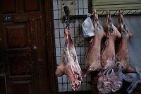 Sheep carcasses hang at a butcher's shop in Kashgar, Xinjiang, China.
