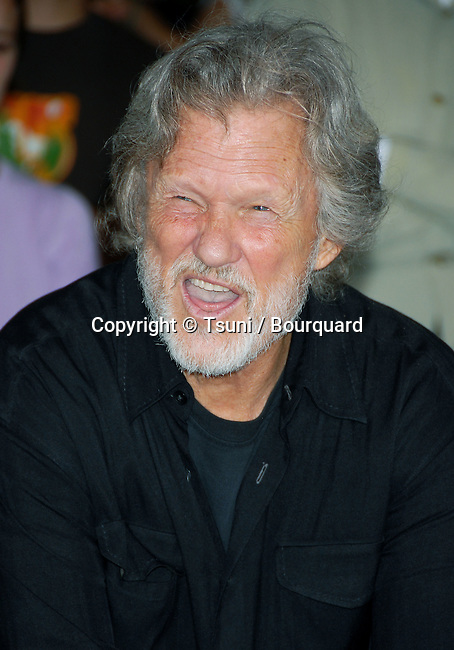 Kris Kristofferson and posthumously Waylon Jennings  get inducted into the Hollywood Rockwalk at the Guitar Center In Los Angeles. July 6,  2006.