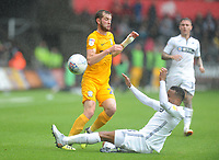 Preston North End's Tom Barkhuizen is tackled by Swansea City's Martin Olsson<br /> <br /> Photographer Kevin Barnes/CameraSport<br /> <br /> The EFL Sky Bet Championship - Swansea City v Preston North End - Saturday August 11th 2018 - Liberty Stadium - Swansea<br /> <br /> World Copyright &copy; 2018 CameraSport. All rights reserved. 43 Linden Ave. Countesthorpe. Leicester. England. LE8 5PG - Tel: +44 (0) 116 277 4147 - admin@camerasport.com - www.camerasport.com