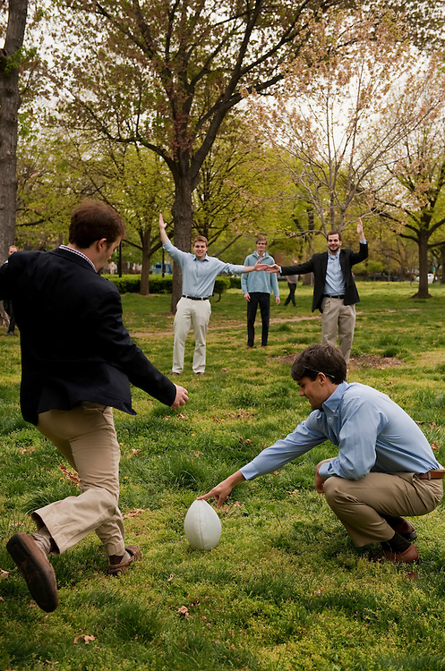 UNITED STATES - APRIL:  Staffers from the office of Sen. Mark Pryor, D-Ark., kick field goals in Stanton Park while waiting out a fire drill that was being performed in the Senate office buildings.  (Photo By Tom Williams/CQ Roll Call)