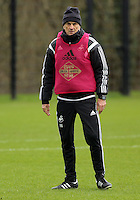 SWANSEA, WALES - JANUARY 28: Head coach Francesco Guidolin observes the players training during the Swansea City Training Session on January 28, 2016 in Swansea, Wales.