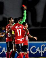 BOGOTA - COLOMBIA - 05 - 02 - 2017: Juan Ponton (Izq.), arbitro, muestra tarjeta roja a Anier Figueroa (Fuera de Cuadro) jugador de Millonarios, durante partido de la fecha 1 entre Millonarios y Deportivo Independiente Medellin, de la Liga Aguila I-2017, jugado en el estadio Nemesio Camacho El Campin de la ciudad de Bogota.  / Juan Ponton (L), referee, shows red card to Anier Figueroa (Out of Frame), player of Millonarios, during a match between Millonarios and Deportivo Independiente Medellin, for the date 1 of the Liga Aguila I-201/ at the Nemesio Camacho El Campin Stadium in Bogota city, Photo: VizzorImage / Luis Ramirez / Staff.