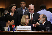 WASHINGTON, DC - SEPTEMBER 27:  Christine Blasey Ford (C) and her attorneys Debra Katz (L) and Michael Bromwich take a break from testifying to the Senate Judiciary Committee in the Dirksen Senate Office Building on Capitol Hill September 27, 2018 in Washington, DC. A professor at Palo Alto University and a research psychologist at the Stanford University School of Medicine, Ford has accused Supreme Court nominee Judge Brett Kavanaugh of sexually assaulting her during a party in 1982 when they were high school students in suburban Maryland.  (Photo by Win McNamee/Getty Images)