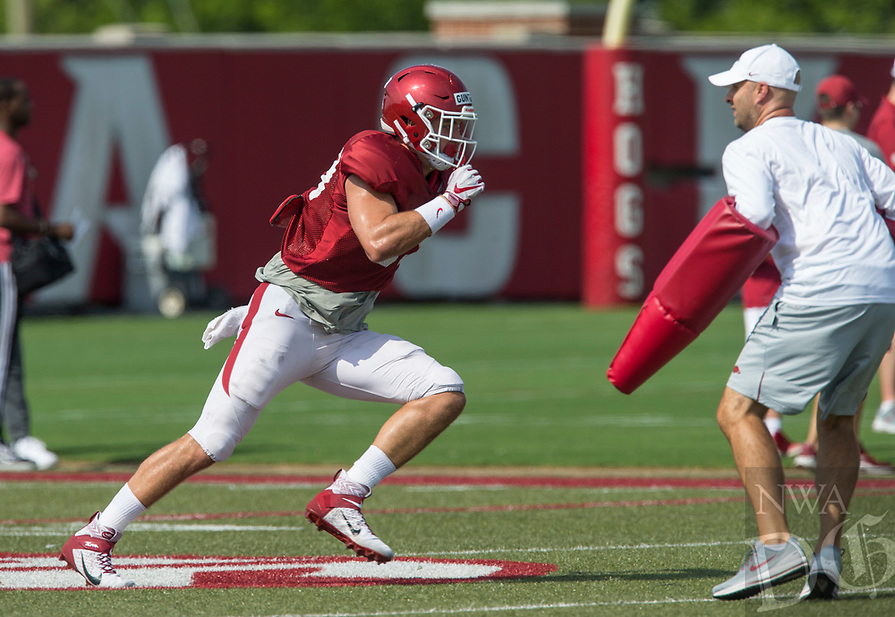 NWA Democrat-Gazette/BEN GOFF @NWABENGOFF<br /> Grayson Gunter, Arkansas tight end, runs a drill with tight ends/special teams coach Barry Lunney, Jr. Wednesday, Aug. 7, 2019, at the Arkansas practice fields in Fayetteville.