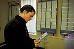 Job Centre young man out of work looking for a job reading vacancy cards. 1998 1990s  Mountain Ash Wales UK